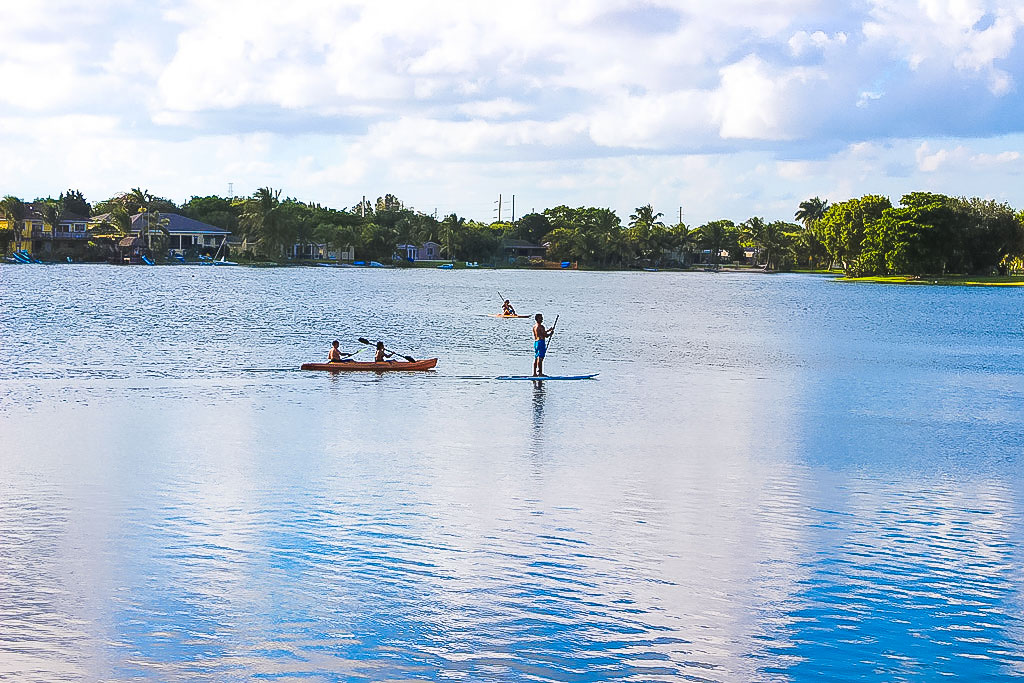 Paddle-boarder-and-kayakers-enjoy-Saga-Bay-Lake